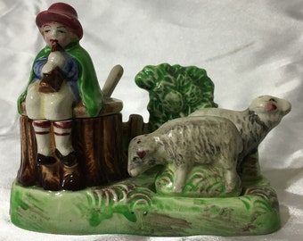 Antique Shephard Boy Playing Flute with Sheep Salt and Pepper Shakers and Sugar Bowl.