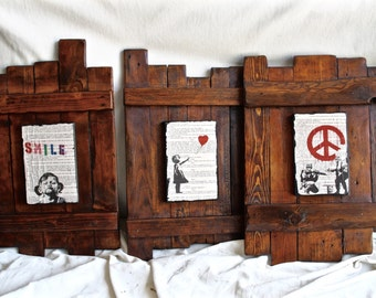 Banksy on the wood ... 3 paintings prints on book pages