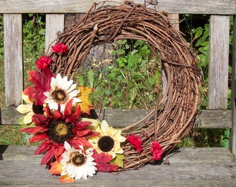 Grapevine Wreath, 14-inch.  Sunflowers in pretty fall colors.  Wall decor, door wreath.  Fall, Thanksgiving.