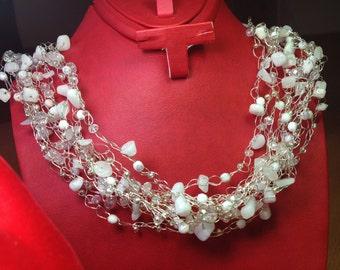 A crochet beaded wire bride necklace