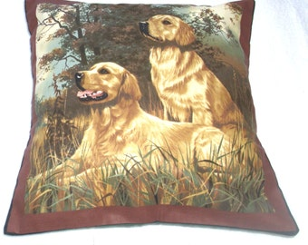 Two golden retrievers eagerly ready and waiting for action cushion