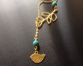 Turquoise charm necklace with a leaf and bird.