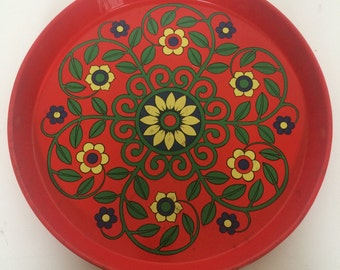 A 1960's red floral tin tray