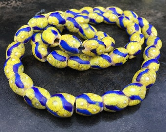 Venetian trade beads.  Strand of yellow and cobalt twisted mille fiore beads, early 20th c.