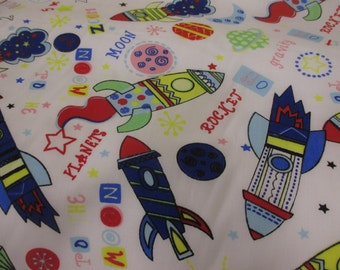 Funky White Spaceships and Rockets Printed Polycotton Fabric. Price Per Metre.