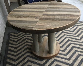 Reclaimed wood table with concrete legs