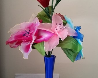 Beautiful Artificial Nylon Flowers in a blue vase