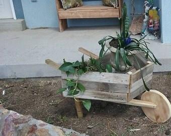 wooden weelbarrow  plant holder