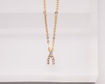 Gold pave tiny wishing bone necklace