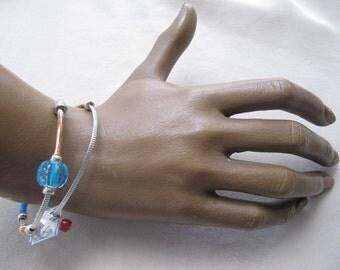 Woman, metal, silver colour, pearl bracelet.