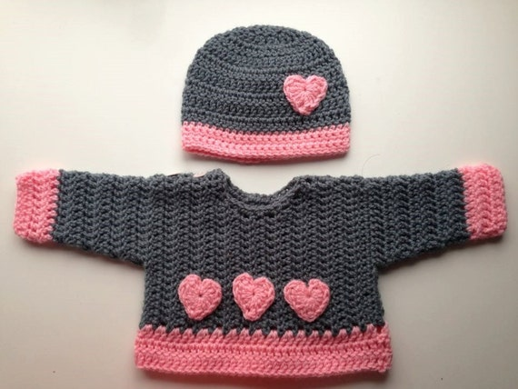 Pink hearts baby sweater and hat set. Grey with pink borders and hearts. Perfect for a baby shower , new baby gift, or for Valentine's day.