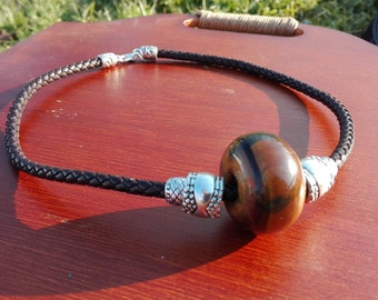Tiger eye tribal leather necklace with metal balls.