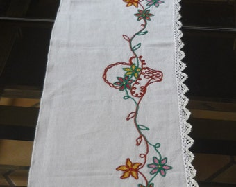 Top of chimney in linen with embroidered flowers decor