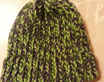 Child size purple and green knitted hat with brim