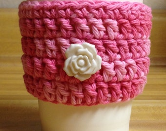 Pink coffee cozy
