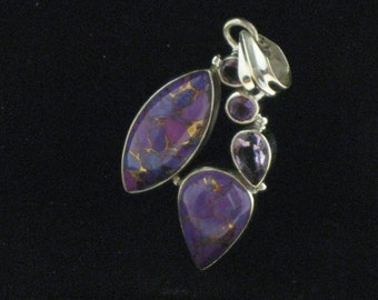 A Gorgeous Sterling Silver Purple Turquoise Pendant with Amethyst Accents.