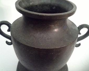 Interesting.....bronze like metal vase