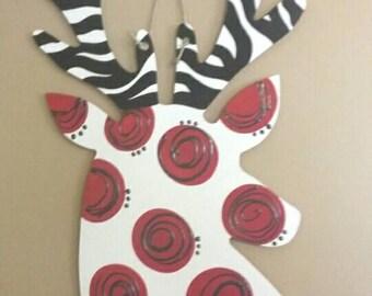 Deer head silhouette door hanger or wall art painted fun & funky with reddish/magenta or pink polka dots and zebra striped antelers.