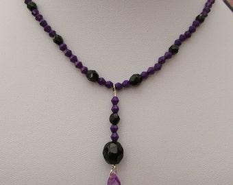 Purple and black bicone necklace with purple pendant
