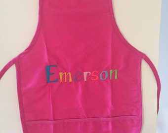 Pink Personalized childs apron with 3 pockets. Will be customized to your liking.