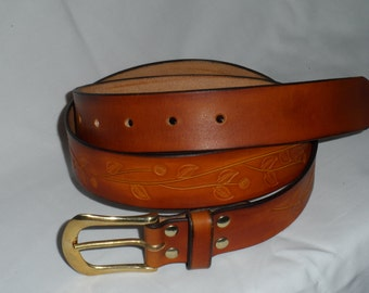 embossed antiqued full grain leather belt with a brass buckle