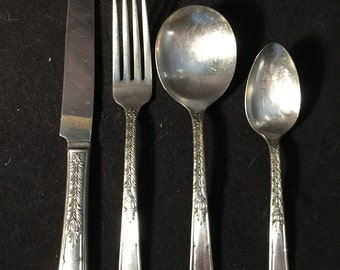 Silverplate Flatware. Janet 1936 Pattern by 1881 Rogers, Oneida Ltd.  Eight 4 place settings with sugar spoon.