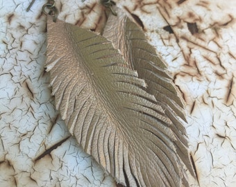 Leather feather earrings in metallic gold leather