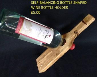 Bottle shaped self-balancing bottle holder