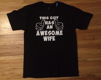 This guy has an awesome wife t-shirt.  Newly wed, honeymoon bound t shirt perfect for a happy husband! Surprise your Mr. with this cute Tee