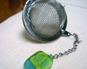Ball to the ball to infuse Murano glass beads