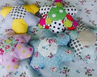 Patchwork flower shaped pin cushion 18cm wide.