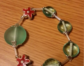 Blue glass and flower bracelet