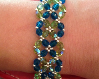 Fire polished glass beaded bracelet with silver clasp