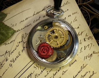 Romantic Steampunk  pendant made of an ancient  pocket watchcase, gears, cristal resin, dial, a red Coral rose