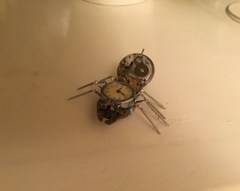 Spider made from watch parts