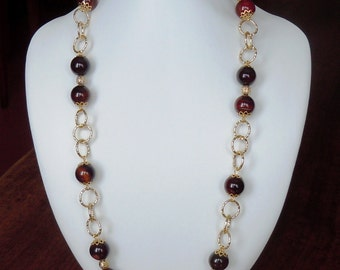 Long necklace of semiprecious stones in natural carnelian