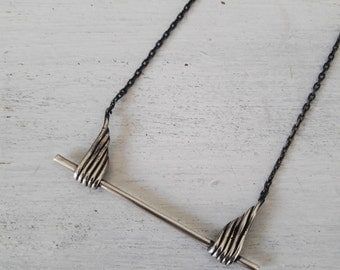 small minimalist feather necklace