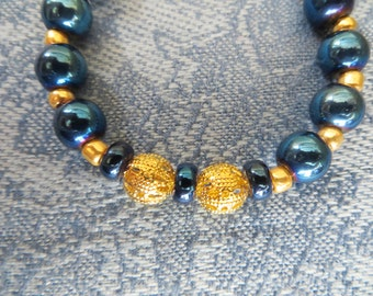 Gold Plated Bracelet with Gold and Swarovski Petrol Beads, GB-58.  Necklace & Earrings available.