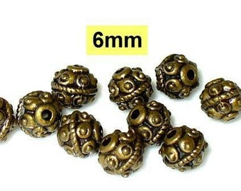 10 beads, beads, spacers, massivBronze 6mm (K107. 6.1)