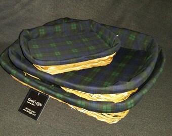 A set of Three tartan lined wicker baskets