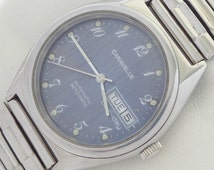 17 Jewels Swiss Made Caravelle set-matic dual day41 automatic vintage watch mint condition.