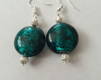Silver earrings with large green stone