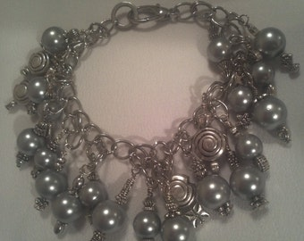 silver colored metal , average size, with earrings