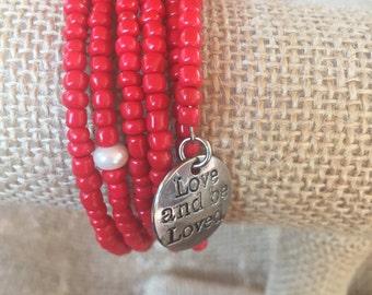 Red glass wrap bracelet with silver charm