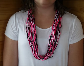 Pink, black, and white chain link scarf.