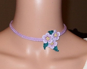 A flirty choker of three flowers offset.