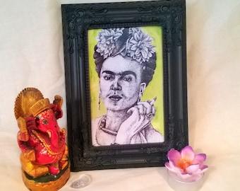 Frida print in decorative plastic frame