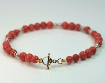Bracelet 750 gold with coral and pearls