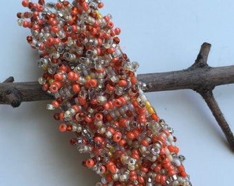 Handmade beaded bracelet. Salmon, white, & clear beads.