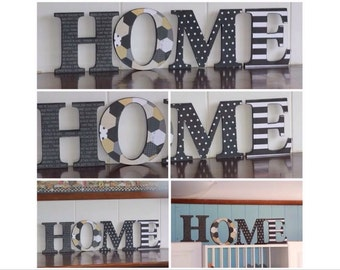 Stunning HOME sign freestanding in black and white color